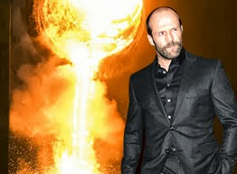 Movie hardman Jason Statham calmly strolls away from a scene of destruction